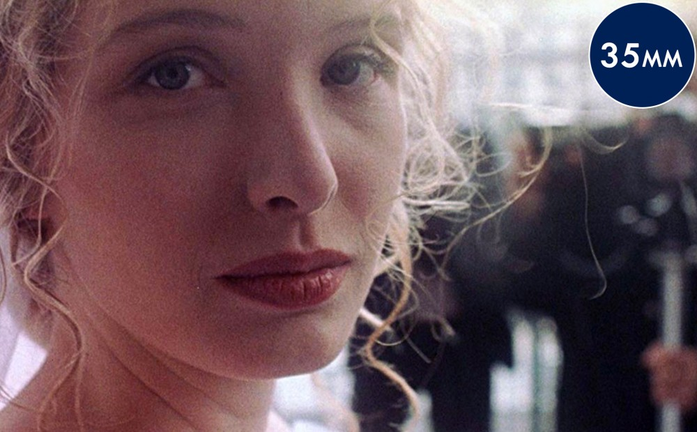 Close-up on actor Julie Delpy's face.
