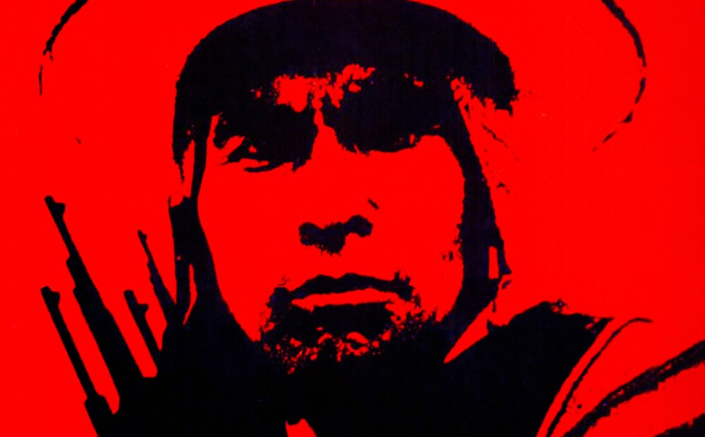 Close-up on the face of a Bolivian campesino from an all black and red movie poster.