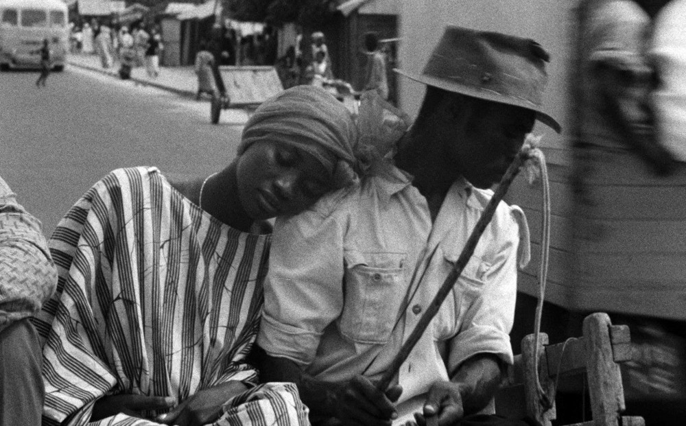From Borom Serret: a woman leans on the shoulder of the man next to her.