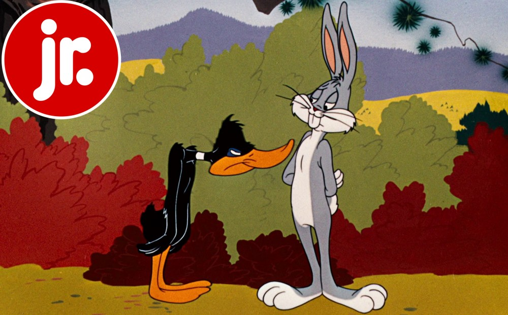 Daffy Duck and Bugs Bunny stand together against a cartoon landscape.