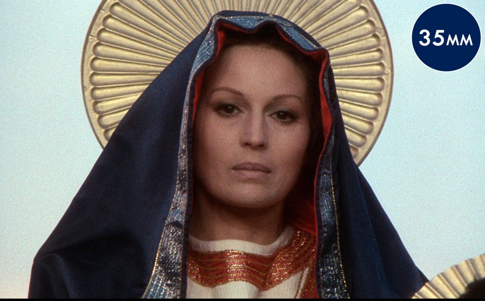 Actor Silvana Mangano as the Madonna, with a halo behind her head, which is covered by cloth.