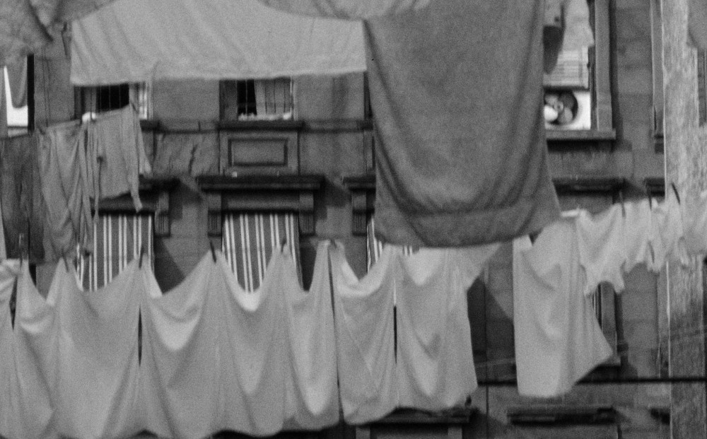 Black and white image of laundry hanging out to dry.