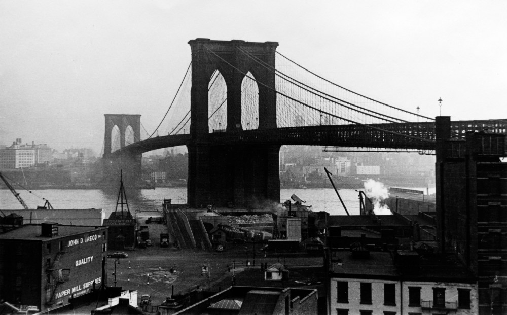 A black and white image of the Brooklyn Bridge.