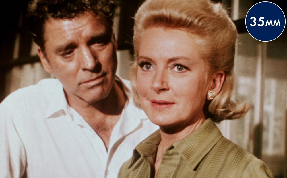 Actor Burt Lancaster looks intently at actor Deborah Kerr.