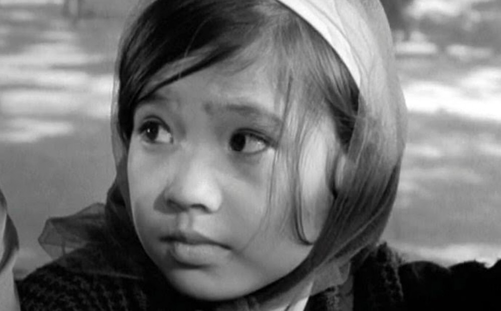 Close-up on the face of a young Vietnamese girl.