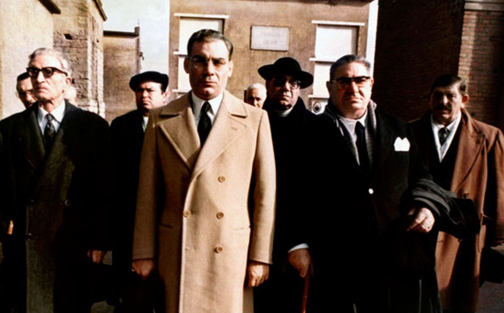 Actor Gian Maria Volontè stands with a group of seven men.