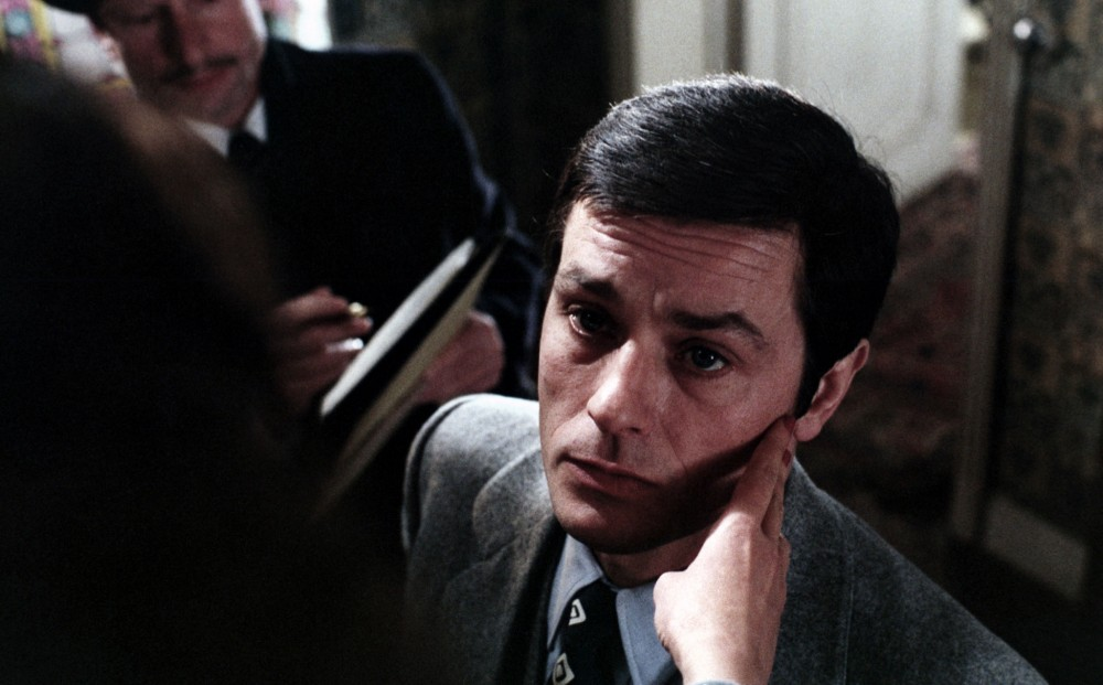 Actor Alain Delon's face from the perspective of the person touching it.