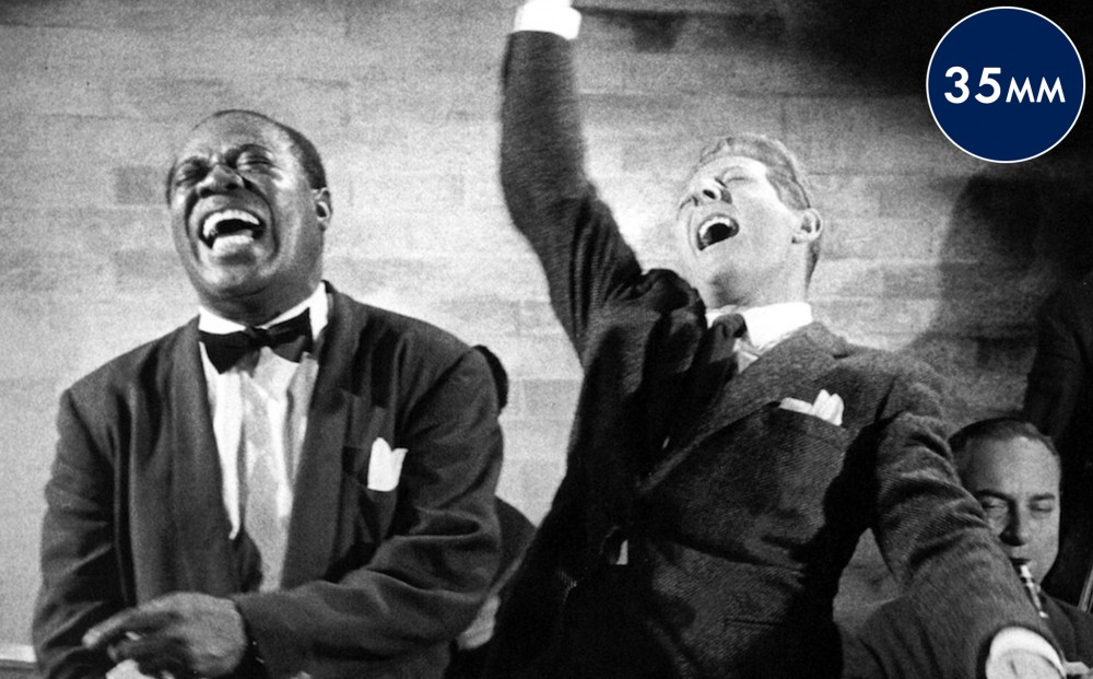Louis Armstrong and another musician perform.