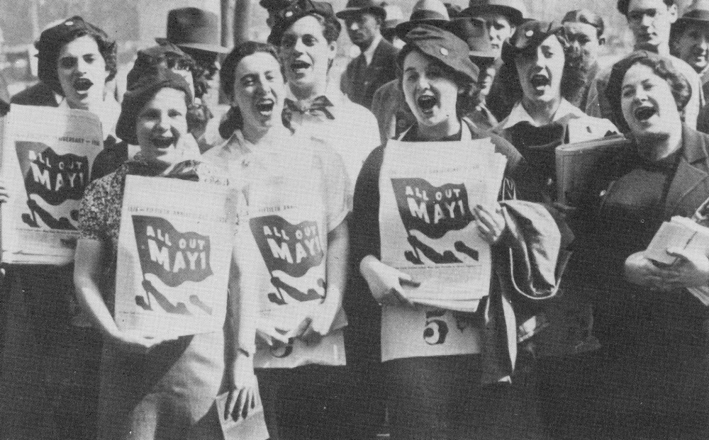Black and white image of a group of women protesting, holding signs that say