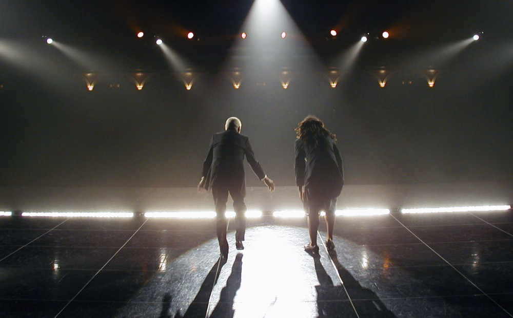 From TAP HEAT - two people tap dance on stage, their backs to the camera.