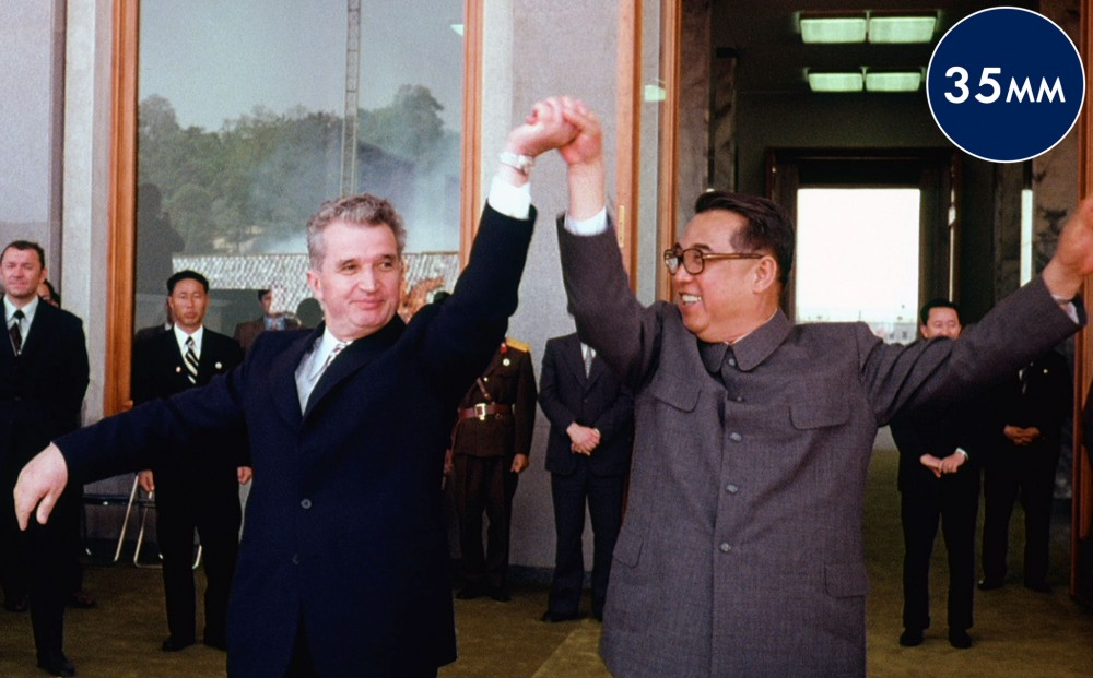 Romanian leader Nicolae Ceausescu raises a clapsed hand with North Korean leader Kim Il-sung.