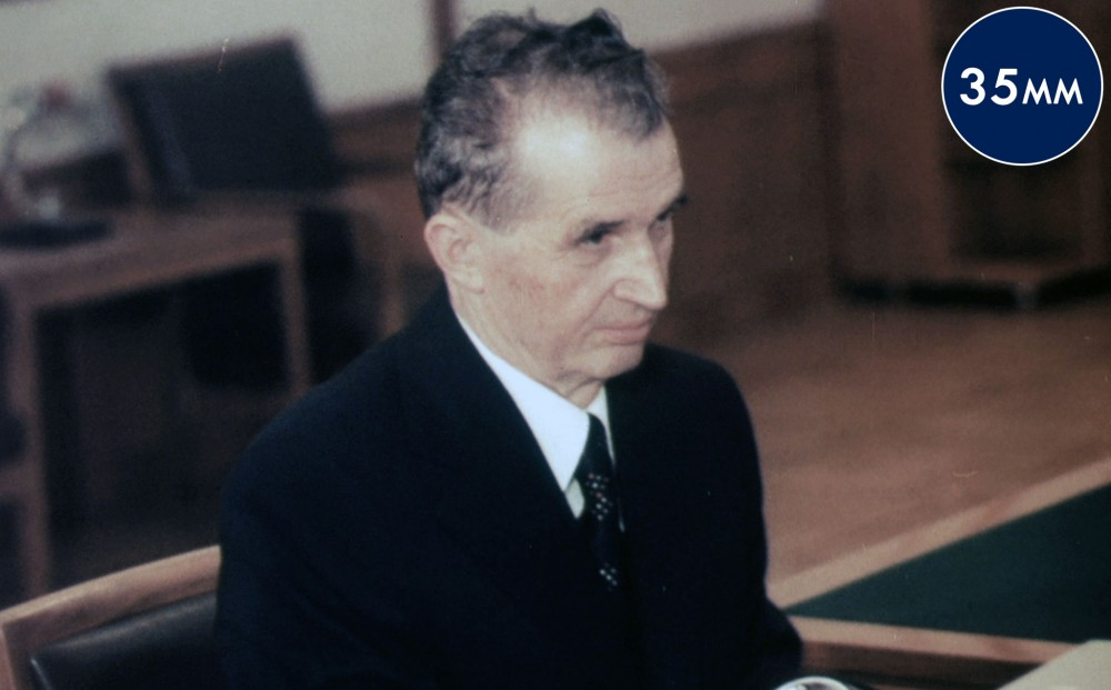 Romanian leader Nicolae Ceausescu sits.