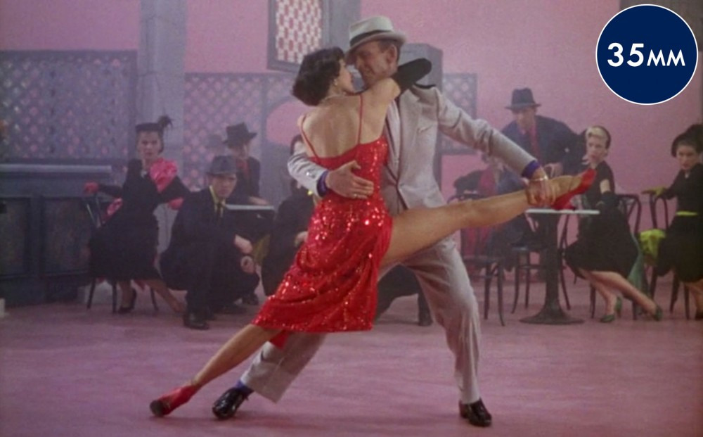Actors Cyd Charisse and Fred Astaire dance together on the set in the film.