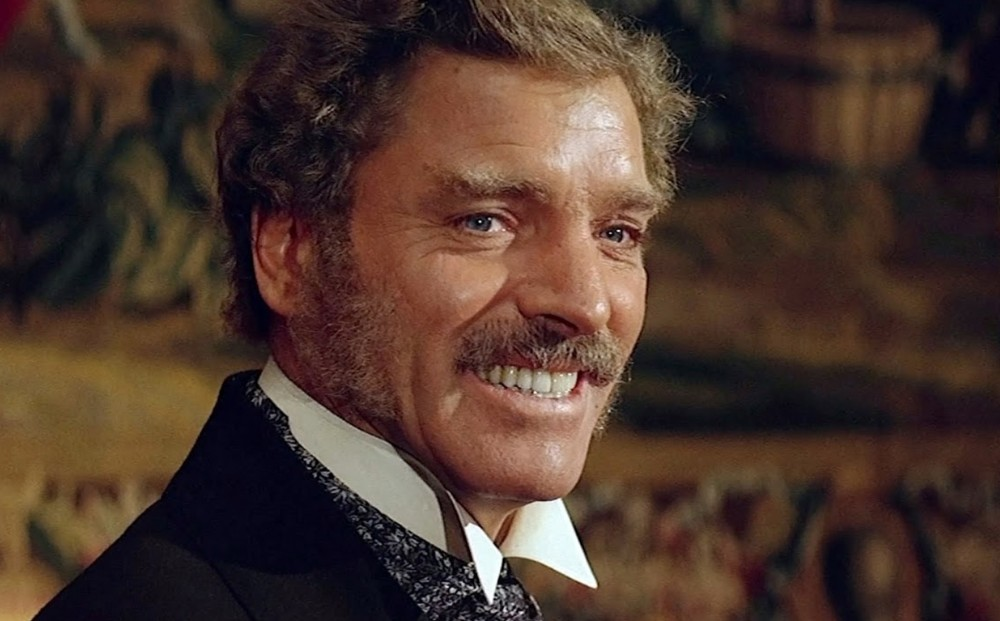 A close-up on actor Burt Lancaster's face, smiling.
