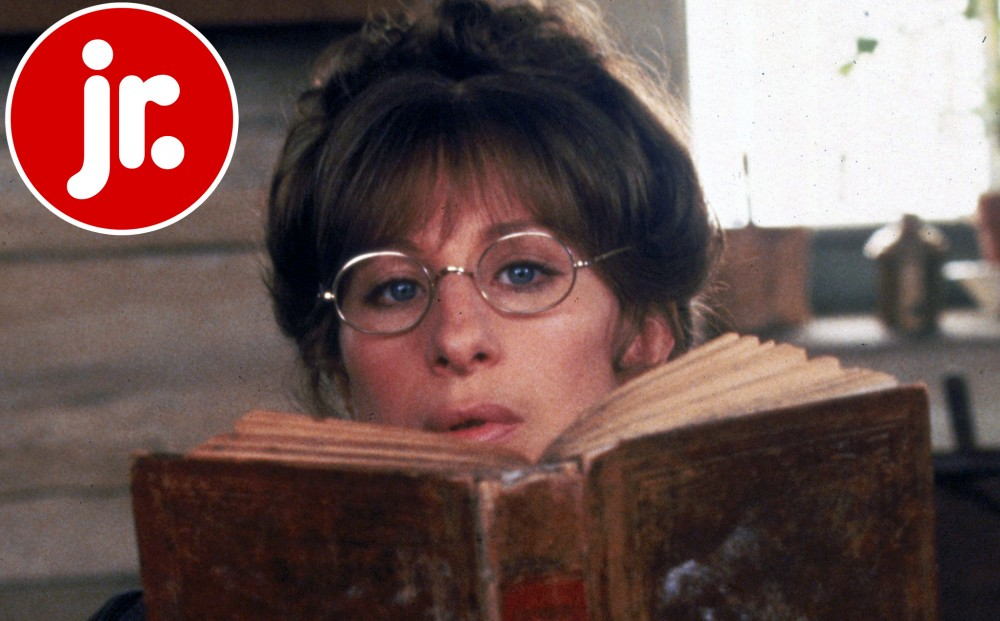 Not in disguise as a man, Barbra Streisand's eyes can be seen just over the book she is reading.