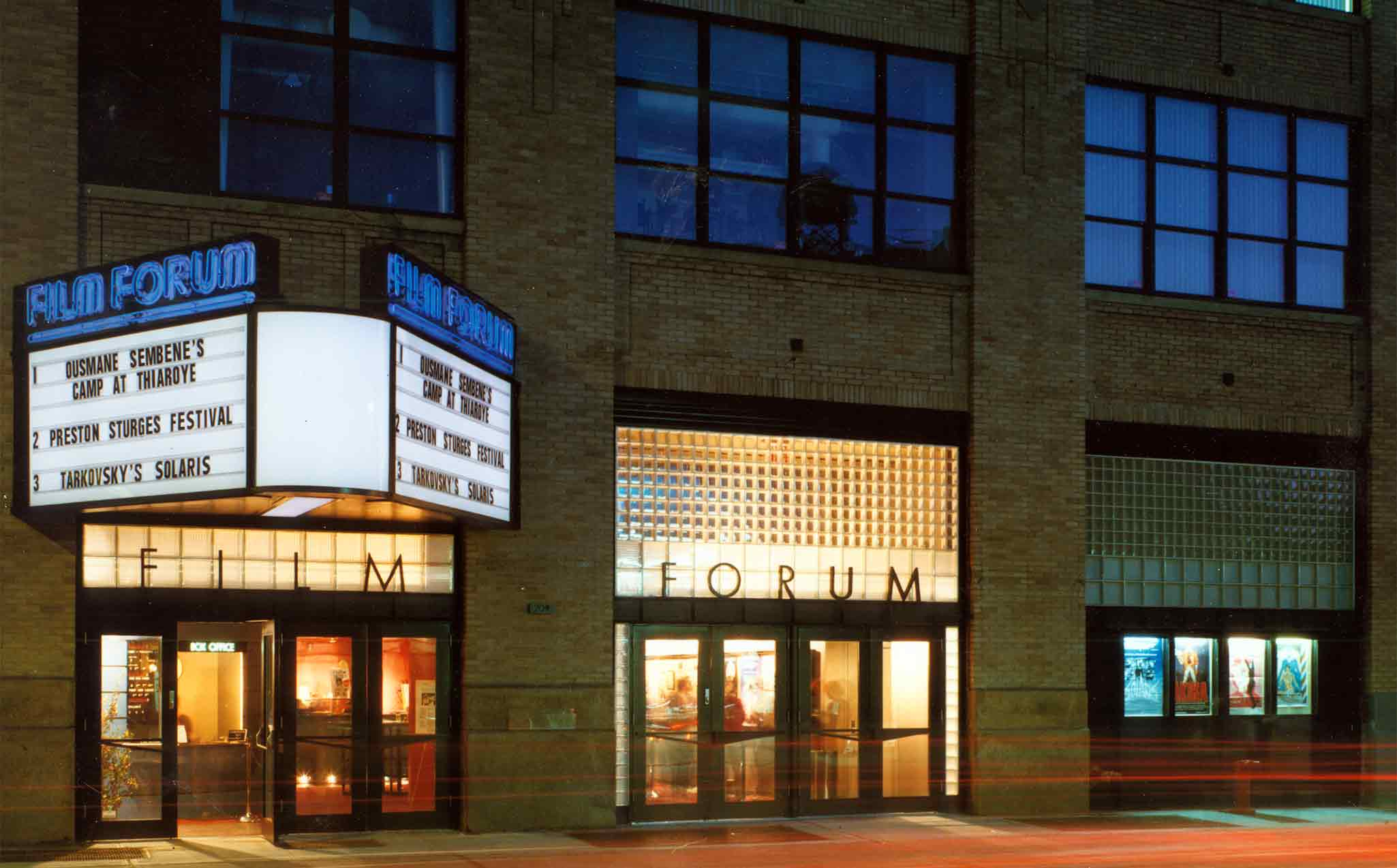 Film Forum's marquee and building, photographed at night